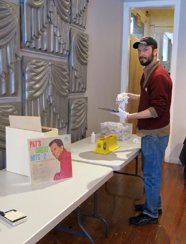 Kurt Peterson cleaning LP albums