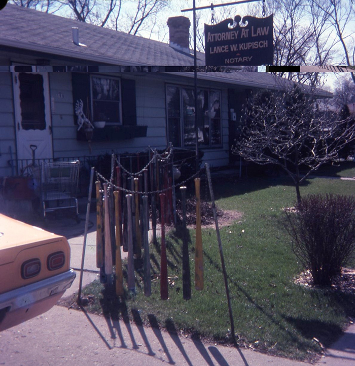 Greg Brown, photo of swinging baseball bat fence in attorney's front yard, c. 1976.